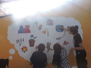 Group collaboration on the mural.