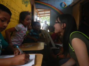 Sarah interacting with one of the students at the Hope Project.