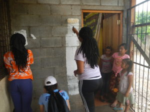 Students look on as the artist group preps the wall for our mural.
