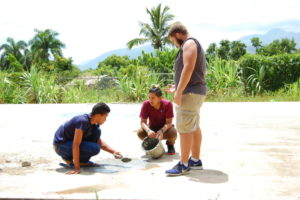 James Pouring cement for the sports area with David and ambassadors