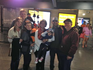 Here is a picture of my family (from left to right): me, my boyfriend, sister, nephew, mom, niece, brother-n-law and my dad