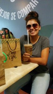 Sarry enjoying a caramel frapachino from a local AIR CONDITIONED coffee shop