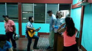 Glimpser Marcelo and English student Mateo going over what song they are going to perform tomorrow for the talent show