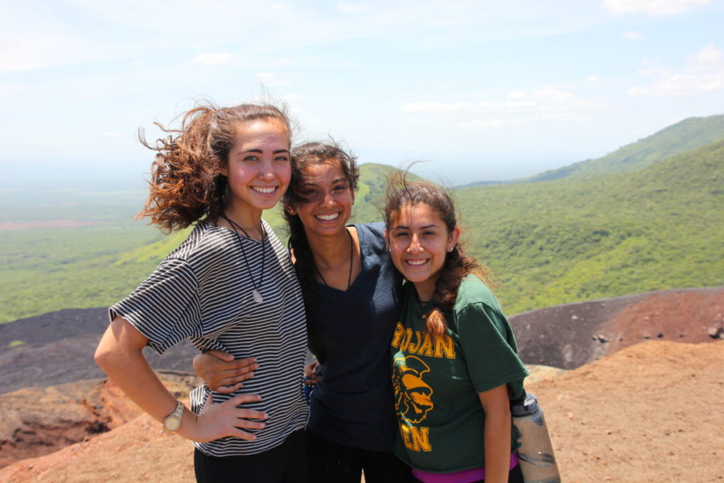 Jamie, Ayesha, and Tatiana enjoying the view and taking pictures on the Cerro Negro