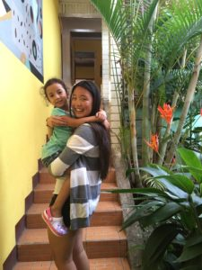 One of our students, Joy, holding the daughter of our hostel owner. The hostel is really starting to feel like home.