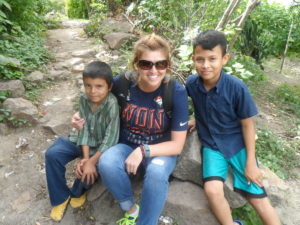 Amy with two of the young boys from the community. The one on the right was 13 years old.