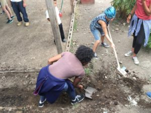 Bianca and Simone shoveling during day 2 of our CAP project