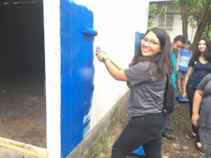 Diana hard at work painting the classroom blue and white to honor both the school's color scheme and the Nicaraguan flag.