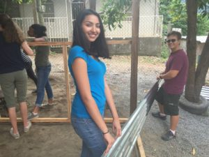 Ritika and Darren use teamwork to help get the classroom finished