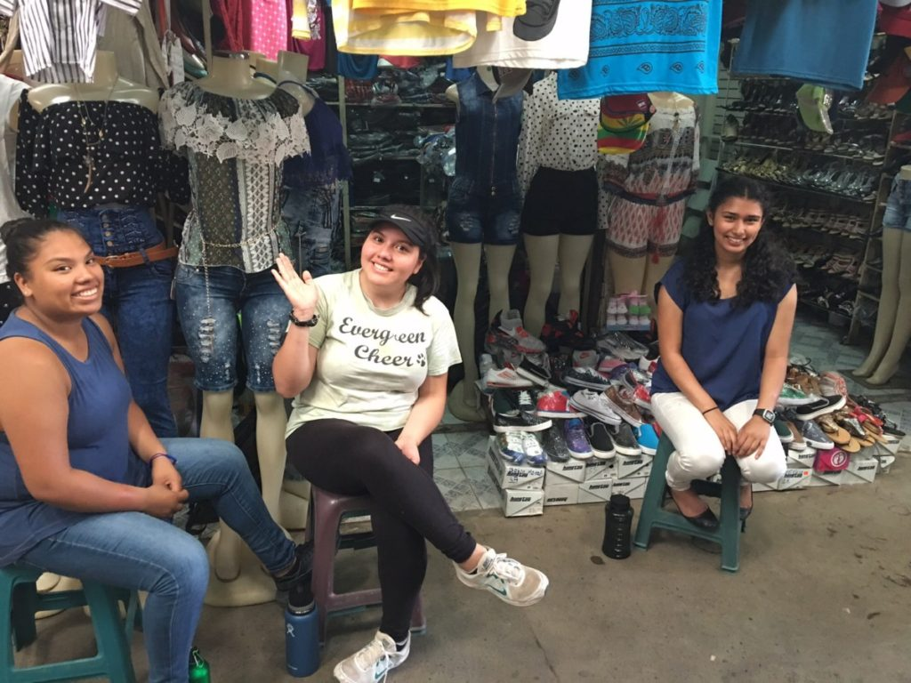 Hairam, Leslie and Karishama working with clothing!